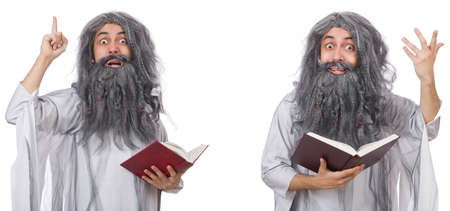 Funny old wizard with book Stock Photo