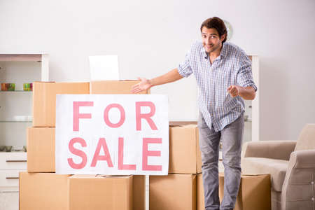 Young man offering home for sale and moving out