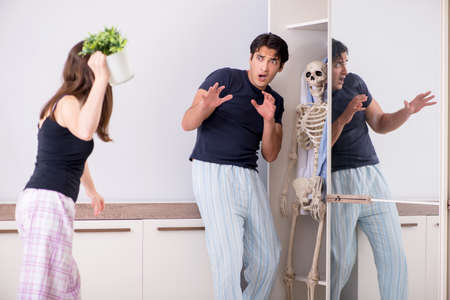 Concept of Skeleton in the cupboard or closet Stock Photo - 116588734