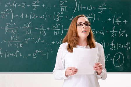 Female math teacher in the classroom