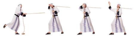 Arab man pulling rope in tug of war concept Stockfoto