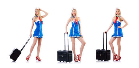Airhostess with luggage on white Foto de archivo