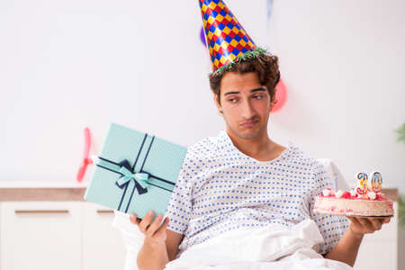 Young man celebrating his birthday in hospital