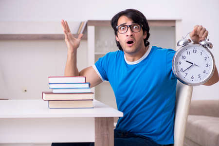 Young handsome student studying at home Stockfoto