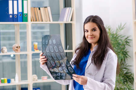 Female doctor radiologist working in the clinic Stock Photo - 117027324