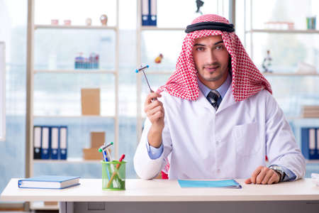 Arab doctor neurologist working in the clinic