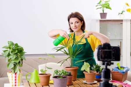 Female blogger explaining houseplants growing