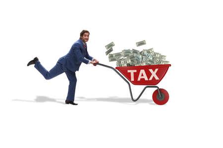 Businessman pushing wheelbarrow full of money in tax concept