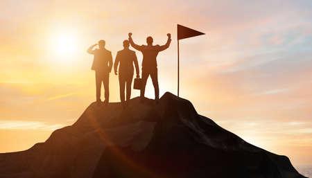 Businessmen in achievement and teamwork concept Imagens
