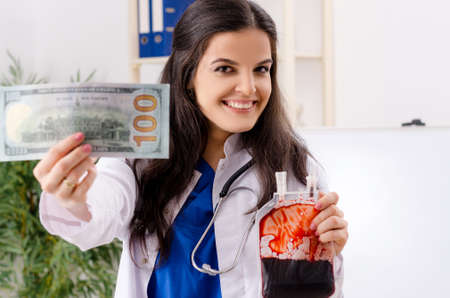 Female doctor in blood transfusion concept