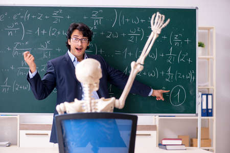 Young male math teacher and student skeleton Stockfoto