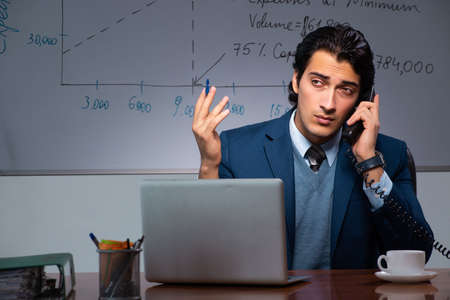 Financial specialist working late in the office Stock Photo