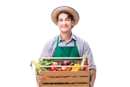 Young farmer with fresh produce isolated on white background