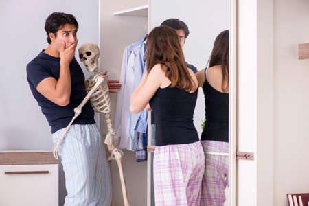 Concept of Skeleton in the cupboard or closet Stock Photo - 118107505