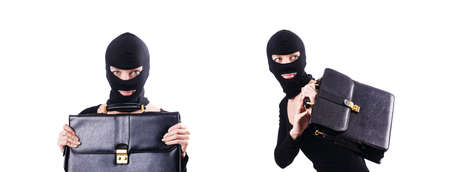 Industrial espionage concept with person in balaclava Stockfoto