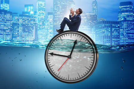 Businessman in deadline and time management concept
