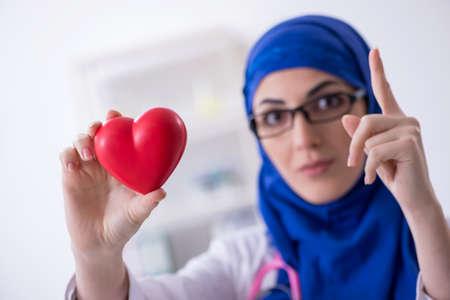 Arab female doctor working in the clinic Фото со стока