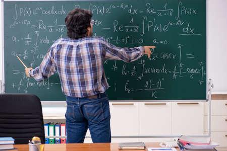 Funny male math teacher in the classroom  版權商用圖片