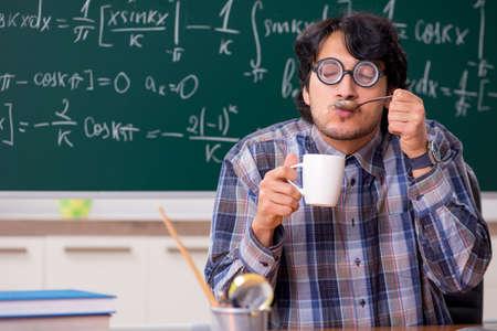Funny male math teacher in the classroom