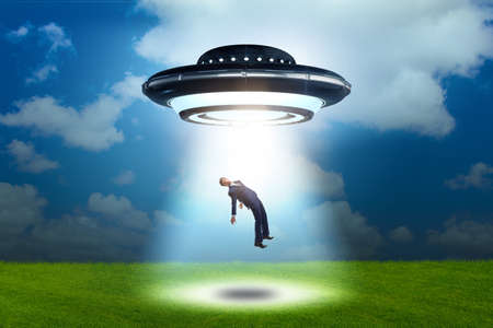 Flying saucer abducting young businessman