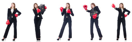 Businesswoman with boxing gloves isolated on white background Stock fotó