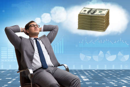 Businessman dreaming of money dollars