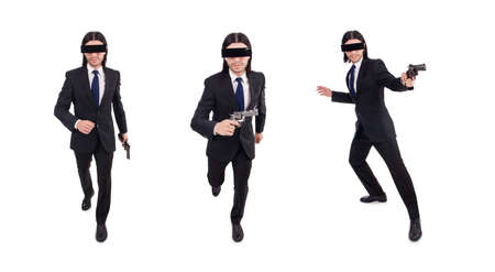 Young man with covered eyes and gun isolated on white Фото со стока