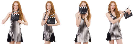 Young beautiful woman holding clapper-board