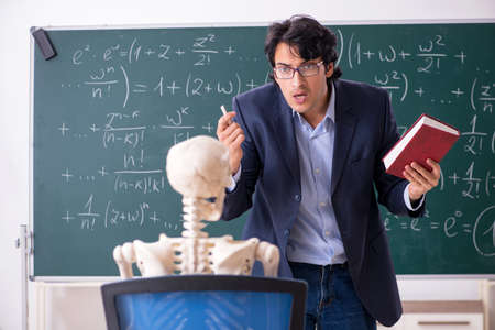 Young male math teacher and student skeleton Stok Fotoğraf