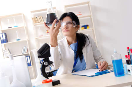 Female chemist working at the lab