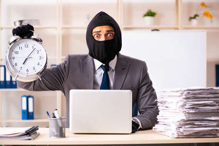 Male gangster stealing information from the office Stock Photo - 118967181
