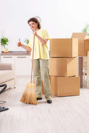Middle-aged woman cleaning new apartment Stock Photo