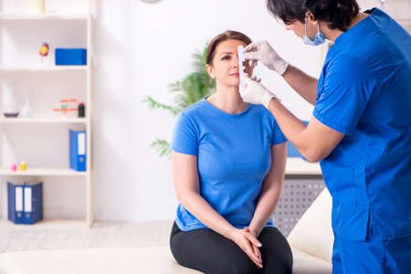 Woman visiting male doctor for plastic surgery