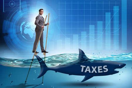 Businessman avoiding paying high taxes Stok Fotoğraf
