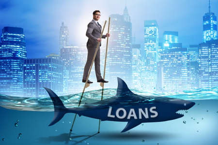 Businessman successfully dealing with loans and debts Banque d'images