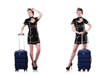 Woman travel attendant with suitcase on white Foto de archivo