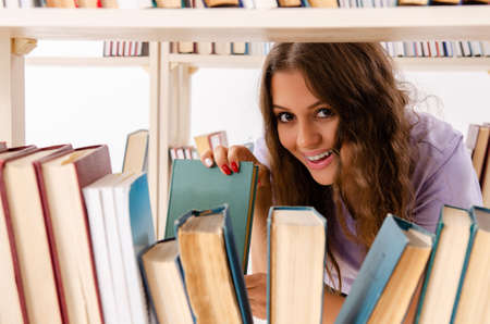 Young female student preparing for exams at library