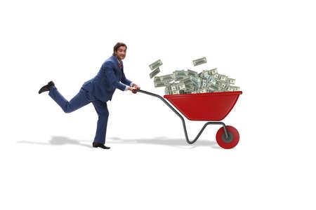 Businessman pushing wheelbarrow full of money