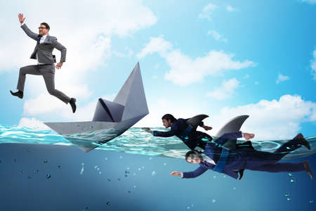 Businessmen in competition concept with shark