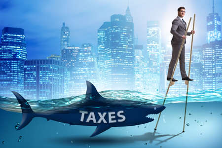 Businessman avoiding paying high taxes Banque d'images