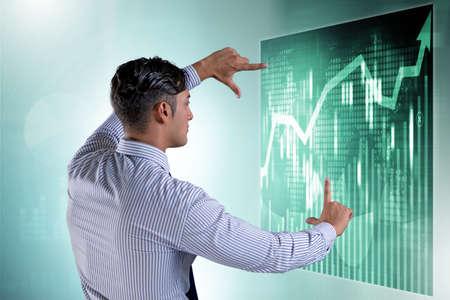 Businessman in futuristic stock trading concept