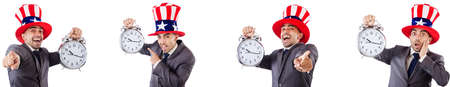 Man with american hat in time management concept Imagens