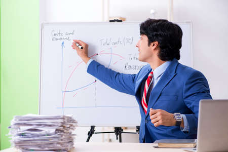 Busy businessman explaining business charts