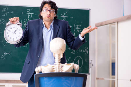 Young male math teacher and student skeleton Stock Photo