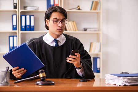 Young handsome judge working in court Stock fotó