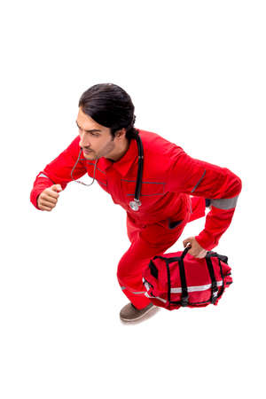 Young paramedic in red uniform isolated on white 版權商用圖片