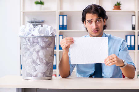 Businessman rejecting new ideas with lots of papers