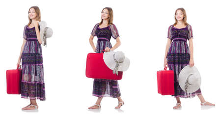 Young woman with suitcase isolated on white background Фото со стока