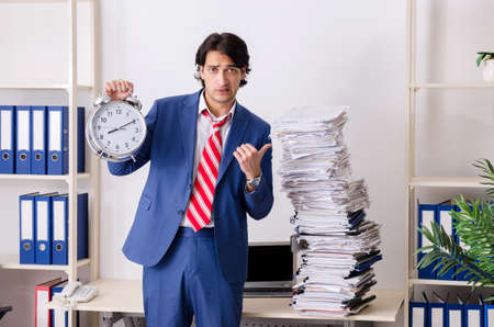 Young businessman employee unhappy with excessive work Imagens