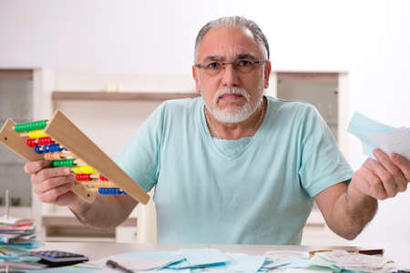 White bearded old man in budget planning concept
